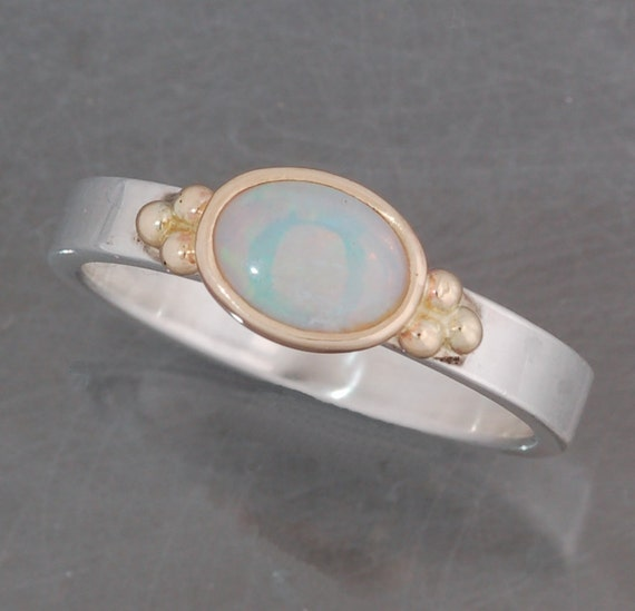 Opal ring in sterling silver and 14 karat gold