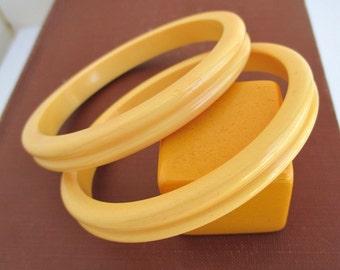 2 Matching Bakelite Bangle Bracelets - Vintage, Yellow w/ Ribbed Edges