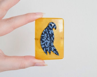 1930s Yellow marbled bakelite brooch with carved Galalith parrot / 30s catalin pin