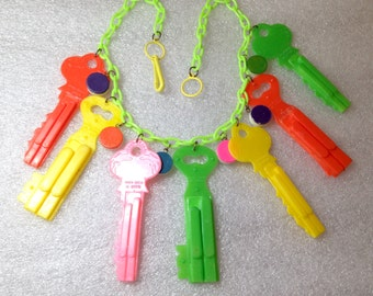 Vintage Pop Art early plastic or celluloid multi colors keys whistles necklace