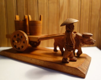 very vintage Folk Art carved wood ox cart with salt and pepper water buckets man and ox