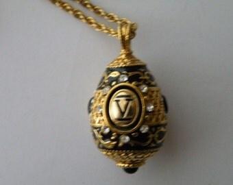 Joan Rivers Black enamel Swarovski rhinestone V egg pendant.