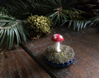 Felted amanita mushroom in a medium blue bottlecap, Red, mushroom hunter gift, woodland desk decor, fairy house decor, dollhouse garden