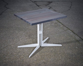 Modern two-top table with oak top and steel legs