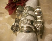 8 assorted napkin rings handcrafted from antique silverware. Free shipping for the holidays USA and Canada only