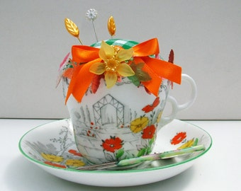 Tea cup and saucer pin cushion. Osbourne china tea cup and saucer.