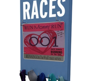 Use A Race Bibs Rack to enhance your wall of fame Display - RACES running bib holder