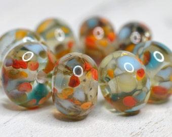 """encased lamp work bead set (8 beads) SRA handmade """"flaming june"""" in aqua, white, orange, topaz encased in crystal clear 71116-7"""