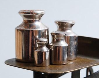 Set of 4 vintage metal weight masses 100 gr, 50 gr, 20 gr, 10 gr for  weighting scale.