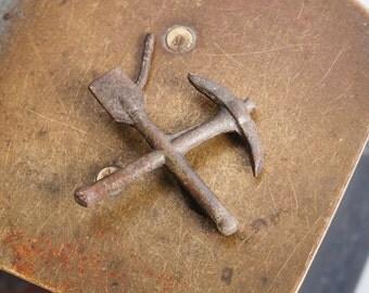 Antique brass plate, part, shovel and pickaxe, finding, dark patina