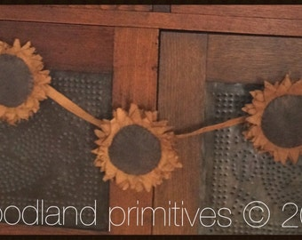 """sunflower garland pattern 44"""" with 3 sunflowers designed and created by Carol Woodard of Woodland Primitives"""