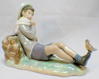 Vintage Lladro Shepherd Boy Resting against a log Sitting with a Bird Retired