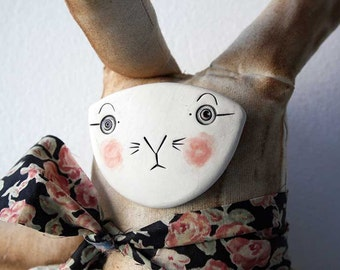 Porcelain faced calico cloth hare-art doll