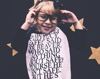 Safe? Narnia quote baseball shirt - girls graphic gold foil tee