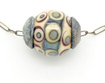 Ancient Carthage Lampwork Focal Bead with Patina Bronze Bead Caps