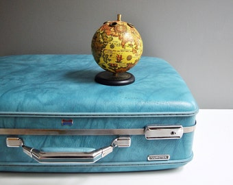 Turquoise American Tourister Suitcase