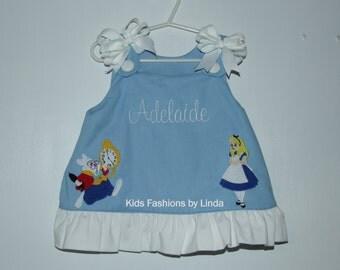 Blue/White Ruffle Aline Dress with Alice Applique