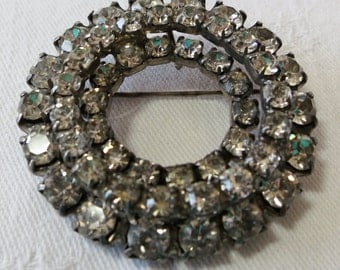 """Lovely old vintage large crystal pin, brooch, 2""""ins across, 3 rings, mixed sized stones, arranged in tiers, open center. CLAM15.3-5.19-3."""