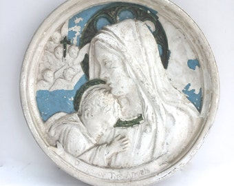 Vintage religious statuary chalk-ware plaque of the virgin Mary holding baby Jesus in her arms