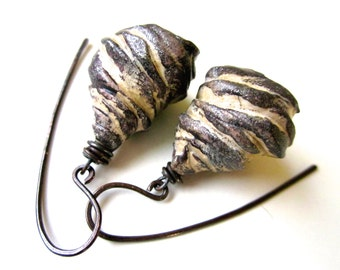 Orphans of the Storm - primitive organic whorled meteorite turban black and white glitter polymer clay bell pod flower, dark copper earrings