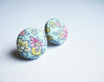 Floral fabric covered button earrings in pale blue, yellow, pink and white