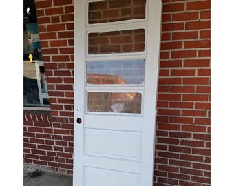 paneled wooden antique white and Blue old architectural salvage door.