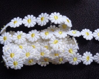 5/8 inch wide daisy  ivory/yellow trim selling by the yard