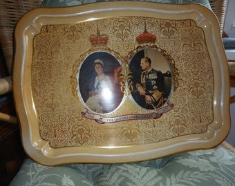 Tin tray showing Queen Elizabeth and Prince Phillip for the Silver Jubilee. Made in England.