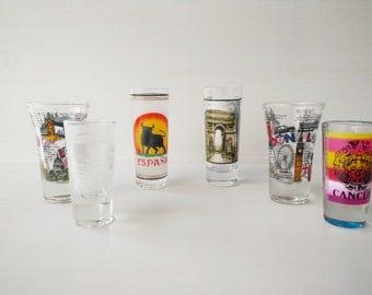 assortment of six shot glasses, glass collectors, souvenier glasses
