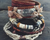 Boho bangle stack with stamped leather wrap, tribal beaded, silk wrapped and spun hemp bangles