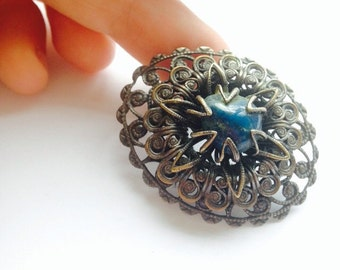 Filigree vintage brooch with blue gemstone - pretty oval shaped - gifts for her - mothers day steampunk