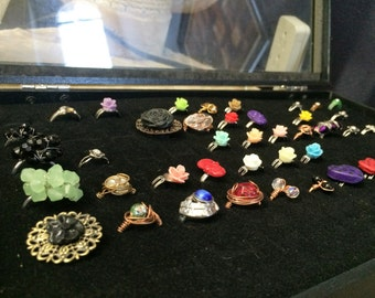 Bulk lot of 45 rings and black display case sold AS IS