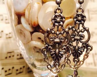 Ornate, floral, filigree earrings, Antiqued Silver toned,  w/fleur de lis charm.  By: Kari Wolf Designs
