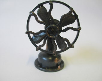 Vintage miniature fan pencil sharpener metal bronze tone used