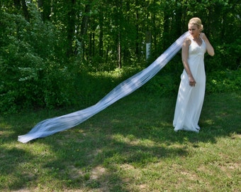 White cathedral veil with serged edge