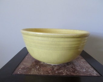 Antique yellow bowl