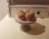 5 muffins on a lovely cake stand