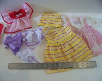 lot of doll clothes various sizes