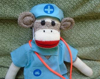 Medical Doctor/Nurse Red Heel Brown Sock Monkey Doll In Scrubs