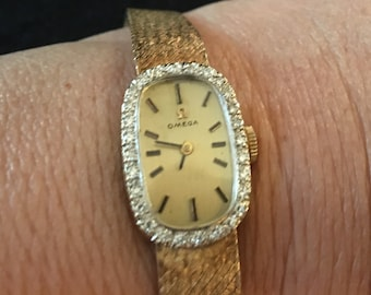 Gold Omega watch set in 14 K gold with diamonds.