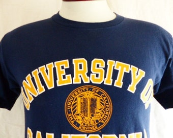 go UCI Anteaters vintage 90's University of California Irvine navy blue graphic t-shirt yellow gold white crest curve block letter logo medi