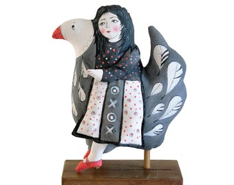girl riding a bird. painted folk art doll - soft sculpture