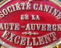 Striking Vintage French Société Canine de La Haute-Auverne Red & Gold Prize Winning Metal Dog Plaque