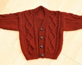 toddlers (boy) hand knitted aran style cardigan age 1 to 2 years in a rust coloured wool rich yarn