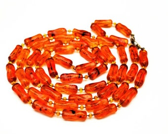 Bead necklace  Amber Orange Lucite plastic nugget 48 inches vintage plastic