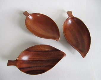 set of three mid century monkeypod leaf bowls