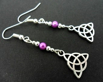 A pair of tibetan silver & purple glass bead celtic knot dangly earrings. new.