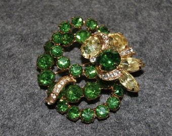 Vintage EISENBERG Pin Or Brooch With Green Yellow And White Prong Set Stones Gold Tone Backing 1950s