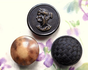 Thread back buttons, antique, 3 different, 1.  metal ptd. portrait, 2. faux tort. celluloid, 3. chequered black weave. 19th. century.