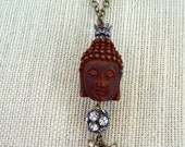Carved Buddha bead with repurposed vintage rhinestone earring, rhinestone beads necklace